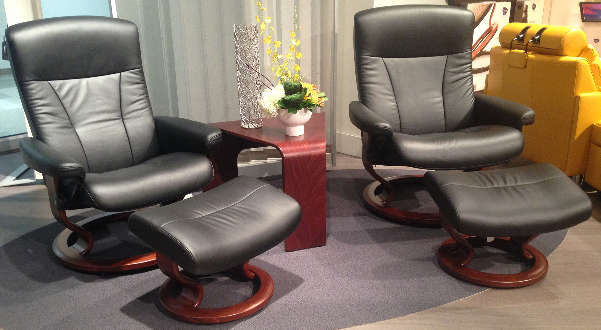 stressless president paloma black leather recliner chair and ottoman